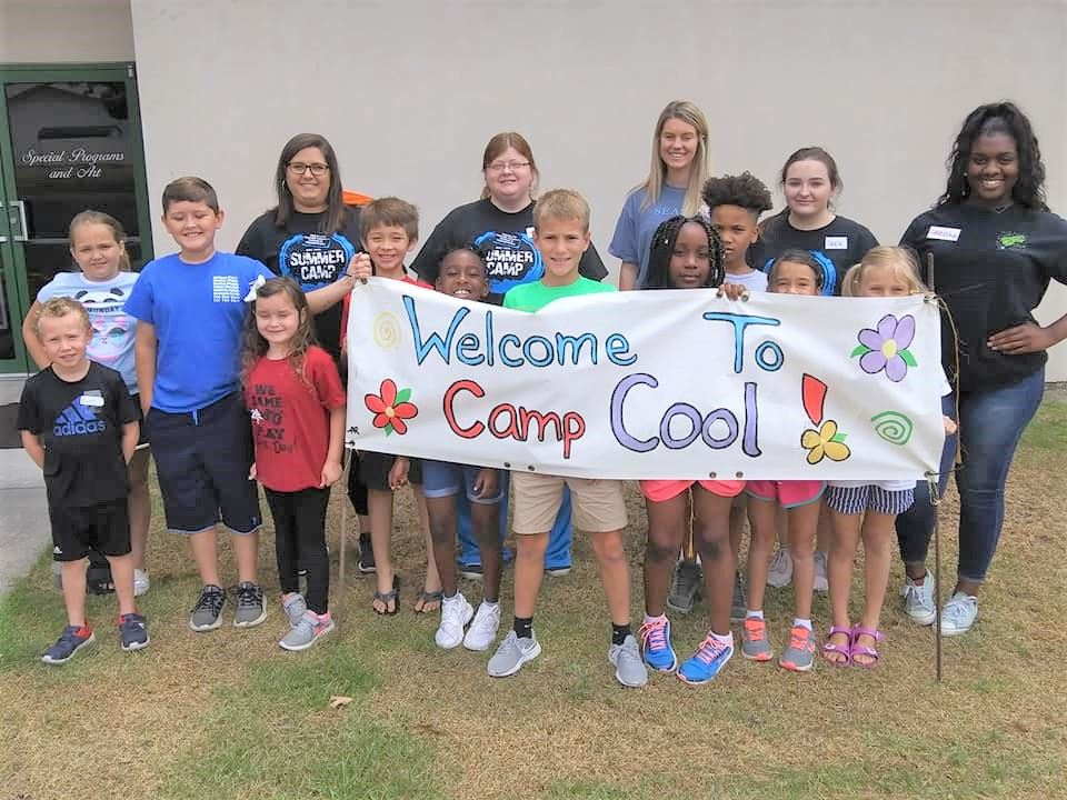 Photo of Children with camp cool sign