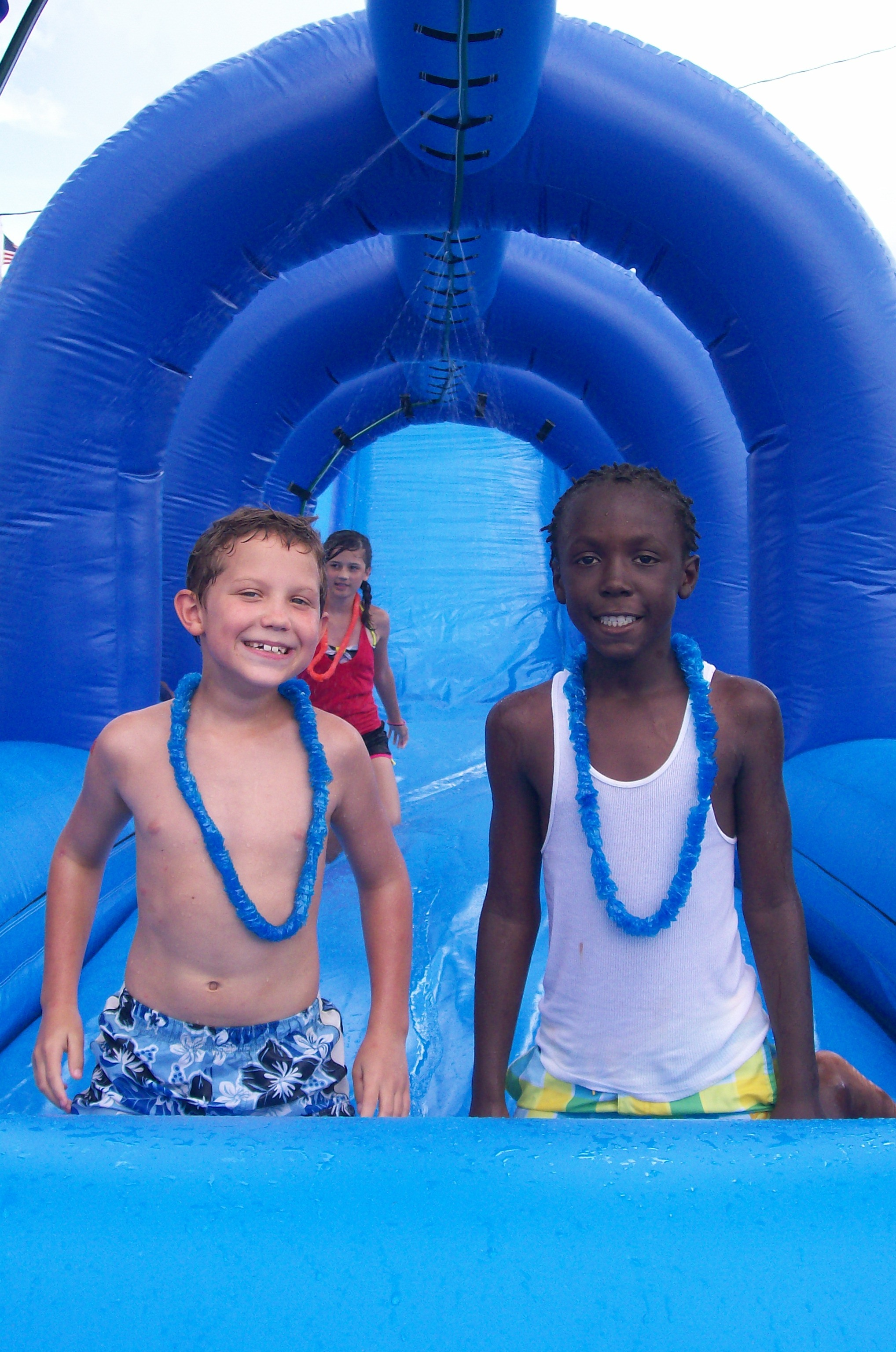 Two local youths enjoy waterslide