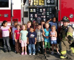 Firefighter and a group of children